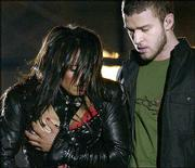 Singer Janet Jackson covers her breast after her outfit came undone during the half time performance with Justin Timberlake at Super Bowl XXXVIII in Houston in this Feb. 1 file photo.