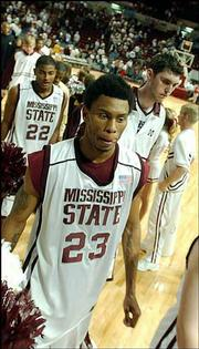 Mississippi State players Winsome Frazier (23), Dietric Slater (22) and Wesley Morgan walk dejectedly off the court. Alabama beat the Bulldogs, 77-73, Saturday in Starkville, Miss.