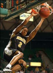 Missouri's Jason Conley dunks against Baylor. The Tigers beat the Bears, 70-66, Saturday in Waco, Texas.