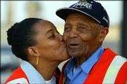 Los Angeles MTA bus driver Success Ballard plants a kiss on Arthur Winston's cheek. Winston, 97, has been working for the Metropolitan Transportation Authority for more than 70 years.