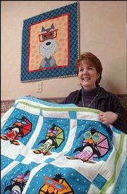 "Lawrence designer Amy Bradley will be featured on HGTV&squot;s ""Simply Quilts"" at 7:30 a.m. Friday. Some of her designs are inspired by animals she meets at her husband&squot;s veterinary clinic."