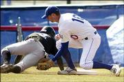 Kansas University second baseman Ryan Baty, right, applies the tag to Creighton's Gabe Lapito during the first inning of the Jayhawks' 5-1 victory. KU won its home opener Sunday at Hoglund Ballpark.