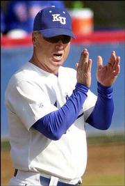 KU coach Ritch Price applauds the Jayhawks after they scored a run in their home opener.