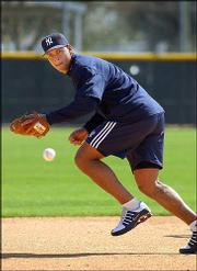 New York's Alex Rodriguez fields a ground ball during practice. The American League MVP -- who is making the switch from shortstop to third base after being traded from Texas to the Yankees -- was practicing Sunday at Tampa, Fla.