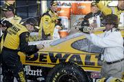 Driver Matt Kenseth, left, and team owner Jack Roush, right, spray each other with champagne after Kenseth won the Subway 400. Kenseth earned his first victory since March 2 in Sunday's NASCAR Nextel Cup Series race at North Carolina Speedway near Rockingham, N.C.