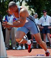 Maurice Greene starts to run a 200-meter race at the U.S. track and field championships in this file photo from Stanford, Calif. Greene, a Kansas City, Kan., native, will compete in the U.S. Indoor Track & Field Championships this weekend in Boston.