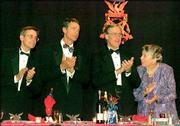 Members of the Walton family, from left, Jim Walton, John Walton, Rob Walton, and mother Helen Walton, applaud at a 1997 banquet in Little Rock, Ark. The Waltons, along with Alice Walton, are tied for the sixth spot on the Forbes list of billionaires.