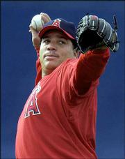 Anaheim pitcher Bartolo Colon warms up during Angels camp. Colon, shown Feb. 20 in Tempe, Ariz., has been tutored in intimidating batters by a master: Boston ace Pedro Martinez.