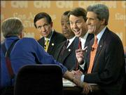 democratic presidential hopefuls, from left, Dennis Kucinich, Al Sharpton, John Edwards and John Kerry answer questions from CNN's Larry King during a debate at the University of Southern California. The four took part in Thursday's debate, five days before Super Tuesday, when 10 states will have primaries and caucuses.