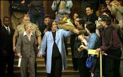 Rosie O'Donnell, center, gets a flower bouquet from well-wishers shortly after marrying Kelli Carpenter in San Francisco. O'Donnell married her longtime girlfriend Thursday, taking what she called a proud stand for gay civil rights in the city where more than 3,300 other same-sex couples have tied the knot since Feb. 12.