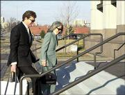 David Wittig, former Westar Energy Inc. chief executive, heads into the federal courthouse in Kansas City, Kan., with his wife, Beth. Wittig was sentenced in a federal loan-conspiracy case to more than four years in prison, a $1 million fine and three years on supervised release after his prison term.
