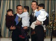 Stephen Knox, left, and Eric Warshaw of Portland, Ore., hold their children, from left, Tilly, Adam and Isac, after their marriage ceremony in Portland, Ore. Warshaw obtained the license earlier in the day after Multnomah County announced Tuesday it would start issuing same-sex marriage licenses on Wednesday.