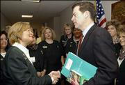 Girl Scouts of the USA Chief Executive Officer Kathy Cloninger, left, meets with Sen. Sam Brownback, R-Kan, and Kansas area Girl Scout representatives Wednesday on Capitol Hill. Cloninger and more than 700 Girl Scout Council representatives are visiting the office of every member of Congress to launch a national dialogue on the issue of girls' safety as part of the Girl Scout Advocacy Day.