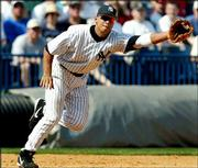 Yankees third baseman Alex Rodriguez stretches for a ball but is unable to come up with the hit by Philadelphia's Jeremy Salazar. Rodriguez made his Yankee debut Friday in Tampa, Fla. New York defeated the Phillies, 7-5.