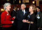 Kansas Gov. Kathleen Sebelius, left, talks with retired Gen. Wesley Clark and supporter Diane Bryant, right, of Olathe, at a downtown Topeka hotel before the Ad Astra banquet for the Kansas Democratic Party. Clark was the keynote speaker at Friday night's banquet.