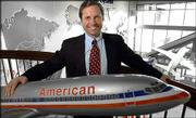 Dan Garton, American Airlines executive vice president for marketing, poses at corporate headquarters in Fort Worth, Texas. Airlines are in a promotional frenzy with miles galore. The free flights will cost American money, but the airline hopes the promotion will fill seats on planes leaving the Northeast.