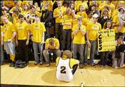 Dumbfounded Missouri fans silently absorb an 84-82 loss to archrival Kansas. The loss Sunday in Columbia, Mo., came in the final game to be played in the Tigers' 32-year-old Hearnes Center.