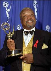 """Paul Winfield displays his Emmy for Best Guest Actor in a Drama Series for his work in """"Picket Fences"""" in this Sept. 10, 1995, file photo. Winfield, who was known for his versatility in stage, film and television roles, died Sunday. He was 62."""