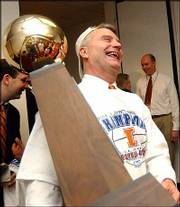Illinois coach Bruce Weber holds the Big Ten championship trophy after Illinois defeated Ohio State on Sunday. His current and his former team, Southern Illinois, each won league championships this season.