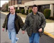 Paul Breakiron, left, and his partner, Gary Nehls, of Uniontown, Pa., leave Asbury Park, N.J., city hall after they were denied an application for a marriage license. The City Council earlier Wednesday had voted to stop taking applications from gay couples.