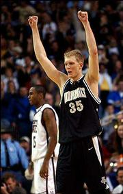 Vanderbilt's Matt Freije (35), a Shawnee Mission West product, raises his arms in victory. The Commodores upended No. 4 Mississippi State, 74-70 in overtime, in the SEC quarterfinals Friday in the Georgia Dome in Atlanta.
