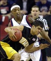 Valparaiso's Miguel Ali Berdiel, front, drives past Gonzaga's Erroll Knight. The Bulldogs won, 76-49, Thursday in Seattle.