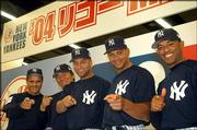 New York Yankees, from left, manager Joe Torre, Hideki Matsui, Derek Jeter, Alex Rodriguez and Mariano Rivera pose during a news conference Saturday. The Yankees play a two-game series against Tampa Bay today and Wednesday in Tokyo.