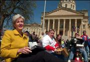 Gov. Kathleen Sebelius, left, sits next to Lawrence members of the Big Tent Coalition. Seated from left are Kathy Lobb, representing the Self Advocates Coalition of Kansas; Michelle Garrison, who is on the developmental disability waiting list; and Brad Linnenkamp, who has cerebral palsy and was dropped from a Medicaid waiver program. Sebelius and coalition members on Wednesday attended the annual Rally For Freedom outside the Statehouse in Topeka.