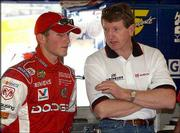 Kasey Kahne, left, gets some driving tips from longtime NASCAR driver Bill Elliott at Nextel Cup practice at Daytona International Speedway.