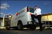 Red Cross employees Ellen Quillen, left, disaster action team captain, and Matt May, disaster committee chairman, hope their newly purchased van will help them get supplies to the Lawrence community faster in a disaster. They are pictured Tuesday at the Red Cross offices, 2518 Ridge Court.