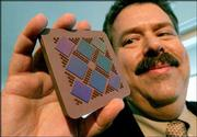 Bernard Meyerson, IBM fellow and chief technologist, displays a Power5 multichip module. He touted the module Wednesday during an IBM news conference in New York. IBM plans to collaborate and build a community of innovation around its Power microprocessor architecture, which can be used in devices such as game systems and supercomputers.
