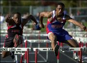 Lawrence High's Sylvester Birdsong, left, and a Leavenworth runner race down the stretch of the 110-meter hurdles. Birdsong placed second in the event Wednesday at the LHS track.