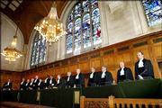 The 15 judges of the International Court of Justice, also known as the world court, stand in The Hague, Netherlands. The court ruled Wednesday that the United States violated the rights of 51 Mexicans on death row and ordered their cases be reviewed.