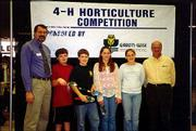 From left are Daryl Buchholz, K-State assistant director of agriculture; Alex Cox, Jacob Cox, Joanna Wakeman, Lacy Hunsinger, members of the Douglas County 4-H intermediate horticulture judging team; and Scott Wise, vice president of Gard 'n-Wise Distributors. The team took second place in state competition March 6 at the Wichita Lawn and Garden Show.