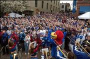 "Kansas University fans ""wave the wheat"" during a pep rally in St. Louis. Officials estimated about 3,000 fans attended Sunday&squot;s event before the men&squot;s basketball game against Georgia Tech University in the NCAA Tournament."