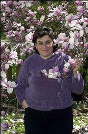 Lawrence poet Caryn Mirriam- Goldberg, shown here in front of a magnolia tree, will read her work Friday at the Lawrence Arts Center during the second installment of the 2004 Lawrence Poetry Series. One of her recent poems is about magnolia trees.