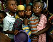 Los Angeles Times photographer Carolyn Cole is this year's winner of the Pulitzer Prize for feature photography. Her submission for the contest included this photo, of displaced children lining up for food at a school complex in Monrovia, Liberia.