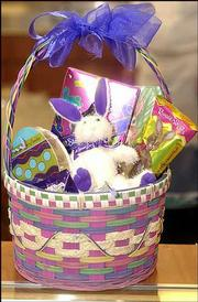 Easter baskets like this one, filled with a stuffed bunny and a variety of chocolates, are proving popular with customers at Russell Stover Candies, 1300 W. 23rd St.
