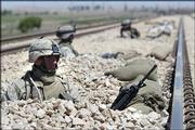 U.S. Marines with the 2nd Battalion 1st Marine Regiment stand guard at a railway on the outskirts of Fallujah, Iraq. Hundreds of U.S. Marines attacked several neighborhoods in the western Iraqi city in order to regain control of the city.