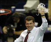 Connecticut coach Gino Auriemma celebrates after the traditional net-cutting ceremony following the Huskies' 70-61 victory over Tennessee. UConn won the NCAA Division One Women's national championship on Tuesday in New Orleans.