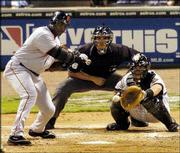 San Francisco's Barry Bonds takes a called third strike as Houston catcher Brad Ausmus waits for the pitcher from Roger Clemens. The Giants were limited by Clemens to one hit in seven innings, and the Astros coasted to a 10-1 victory Wednesday night in Houston.