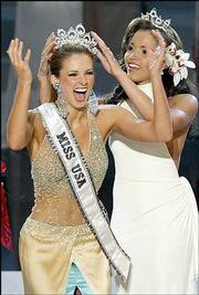 Miss USA 2004 Shandi Finnessey, from Missouri, receives her crown from Miss USA 2003 Susie Castillo during the 53rd Annual Miss USA Competition at Kodak Theatre in Los Angeles. The ceremony was Monday.