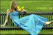Laura Parkinson, LHS sophomore, wears a blue prom dress with cross ties in the back. The dress is from Maurice's, 739 Mass.