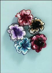 "This flower clasp can be bought with elastic to wrap in the hair or with a pin. $6.95. Visit <a href=""http://promgirl.com"" target= ""_blank"">promgirl.com</a>."
