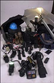From knee-high wading boots to a Leatherman all-purpose tool, an assortment of gear, in addition to a photographer's camera, can be neccessary to complete a photo assignment.
