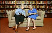 Dorothy Anderson, 94, left, and Georgiana Brune, 92, are longtime patrons of the Lawrence Public Library. Today, both rely on the library's Bookmobile service to get reading material to their residence at Presbyterian Manor, 1429 Kasold Drive. They are pictured on Tuesday at the manor's library.