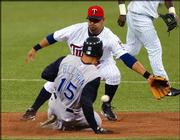 Kansas City's Carlos Beltran (15) safely slides into second with a steal as Minnesota second baseman Luis Rivas reaches in vain for the ball. The Twins beat the Royals, 8-3, Sunday in Minneapolis.