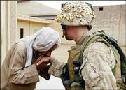 An Iraqi civilian kisses the hand of U.S. Marine Cpl. Joseph Sharp after Marines from the 1st Battalion 5th Marines gave him a supply of food and water in Fallujah, Iraq. American officials and civic leaders from Fallujah called on insurgents Monday to turn in their weapons, in the first concrete statement to come out of direct negotiations. Sharp is from Peoria, Ill.