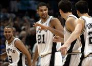 San Antonio spurs players, from left, Tony Parker, Tim Duncan, Hedo Turkoglu and Manu Ginobili, celebrate during the fourth quarter. Parker scored a game-high 27 points, and Duncan added 23 points and 12 rebounds as the Spurs won their first-round playoff game against the Grizzlies, 87-70, Monday in San Antonio.