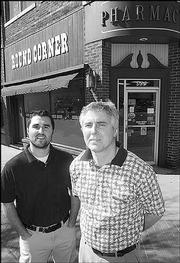 Tom Wilcox, right, has owned Round Corner Drug Store, 801 Mass., for 18 years. His son, Nick, left, is studying to be a pharmacist and works part time at the drug store.